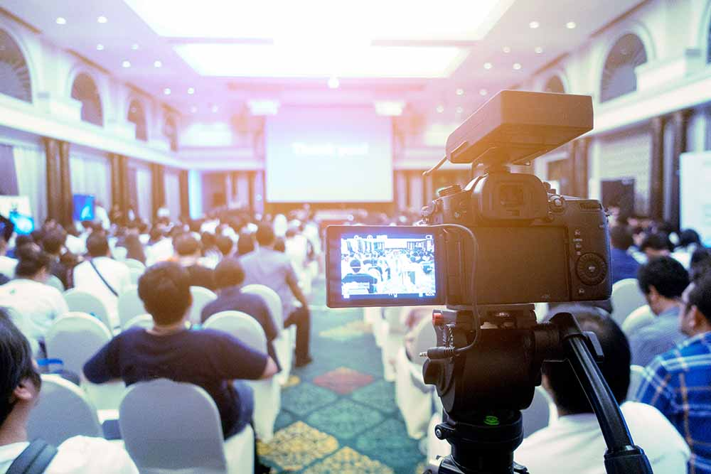 Video Outcomes event videographers filming at conference
