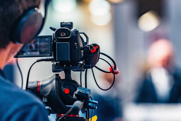 Corporate video production camera operator films an event in Melbourne