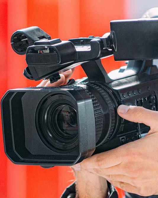 Corporate videgrapher holds video camera in Melbourne
