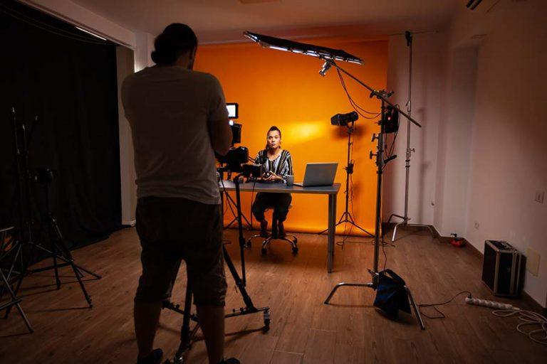 Video Outcomes video production studio. Camera operator films social media video production