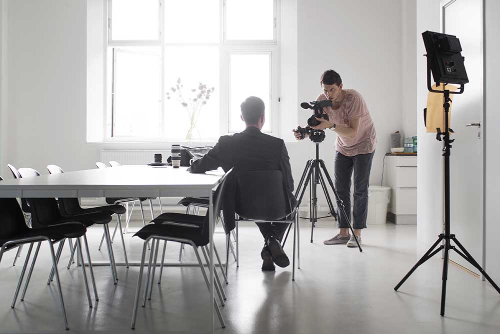 Example of Video Outcomes videographer giving corporate interview in front of camera